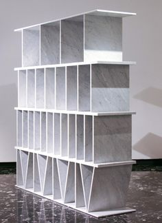 "Paolo Ulian for Le Fablier  ""Numerica"" bookcase, subtly reproduces Roman numerals in standard marble tiles."