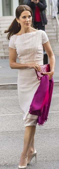 One of Crown Princess Mary's go-to outfits for official duties is an off-white shift-seen at a dinner in Hamburg in May, 2015.