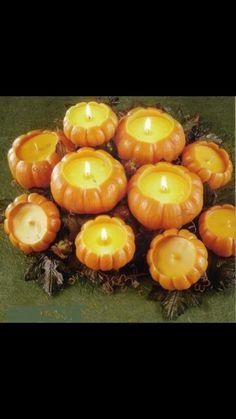 Pumpkin candles for a wedding centerpiece