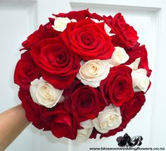red-cream-rose-bouquet by Blossom Wedding Flowers, via Flickr. Bridal bouquet of deep red and soft cream roses bound in off white satin and pinned with pearls