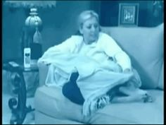 This woman who can't unfold a blanket. | 33 Infomercial Characters Who Need To Get Their Crap Together