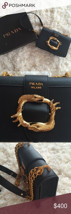 Cahier Snake Bag This is an inspired Prada Cahier bag. **(Price reflects)** Just bought but it's a little too small for me. Bag in new condition. Comes with box. Box is worn. Will consider reasonable offers! Feel free to comment if you have questions or would like additional photos! Prada Bags Crossbody Bags