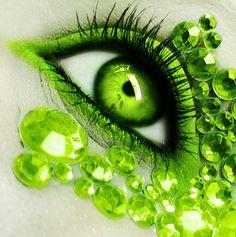 Lime green eyeshadow and embellishments.