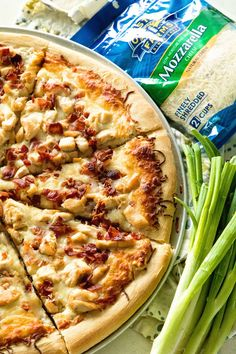 Chicken Bacon Ranch Pizza ~ Delicious Homemade Pizza Piled with a Creamy Ranch Sauce, Chicken, Bacon and Cheese! Perfect for Pizza Nights at Home! ~ https://www.julieseatsandtreats.com