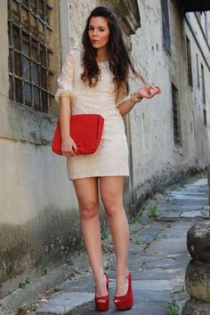 Love the red accents with the romantic dress!