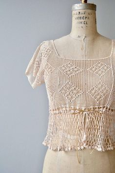 Antique 1910s short sleeve crochet blouse with square neckline ribbon waist cinch. Very, very pale pink color with contrasting crochet design panel below the waist.  --- M E A S U R E M E N T S ---  fits like: small shoulder: 17.5 bust: 32-34 length: 18 brand/maker: n/a condition: excellent  ➸ More tops & sweaters https://www.etsy.com/shop/DearGoldenVintage?section_id=5800171  ➸ Visit the shop http://www.DearGolden.etsy.com ____________________...