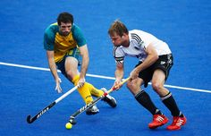 Russell Ford of Australia battles for the ball with Moritz Fuerste of Germany during the Men's preliminary match between Germany and Australia during the Visa International Invitational Hockey Tournament as part of the London Prepares series at Riverbank Arena - Hockey Centre on May 3, 2012 in London, England.          © Paul Gilham/Getty Images