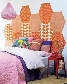 Patchwork headboard using wall paper. (Painted hexies in pastel shades?)