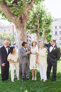 70ec19aef03 Flower crown peonies. Family wedding fun. Ivory on ladies and black and gray  suits on men. Peonies