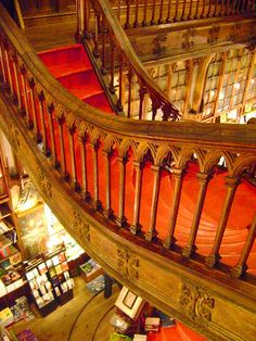 I love gothic woodwork, especially arches.  The red carpeting and odd staircase is perfect!