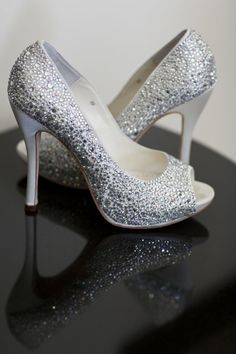 Elegant and Chic Beach-Inspired Real Wedding-A pair of dazzling crystal-encrusted wedding shoes