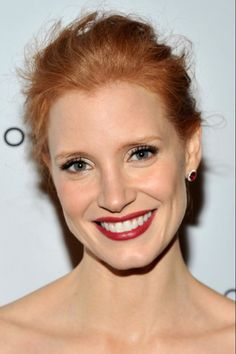 Jessica Chastain with ruby lips and gold-rimmed eyes
