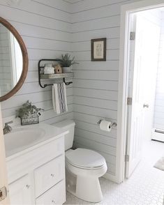 This bathroom of @decor_and_dogs is so pretty! It makes me want to shiplap out main bathroom like right now! I just love the shelves and mirror too!! #ourrusticfixer #bathroom #bathroomshiplap #shiplapbathroom #bathroomdecor #farmhouse #farmhousestyle #farmhousedecor