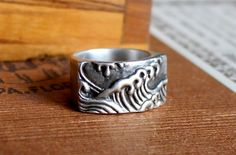 Hey, I found this really awesome Etsy listing at https://www.etsy.com/listing/78247486/sterling-japanese-inspired-wave-ring