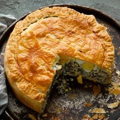 This savoury pie is often made using several layers of filo pastry, but I like the robustness of puff. The pie keeps well, so it's a great dish to have in the fridge over the Easter weekend. If you can't get chard, use spinach or another green. Serves six to eight.