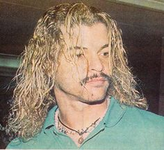 a rare shot of colombian football legend carlos valderrama letting his hair down.