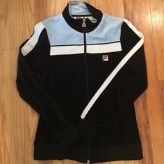 Fila zip up jacket, vintage looking. W-m. Super cute and soft vintage looking FILA zip up jacket. Color scheme, light blue, black and white. Made of 80% cotton and 20% polyester. No flaws. Fila Jackets & Coats