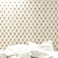 can you believe this is wallpaper and not a tufted headboard