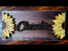 String Art- Name, colour, stained wood, nails, flowers Made By: Jennifer MacLeod Schutt
