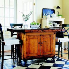 Repurpose Furniture - turn almost any piece of furniture into a movable kitchen island by attaching casters.  If the top is too small, screw a larger one in place.