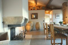 Charming stone fireplace and wooden furniture | Pure Villa Belle