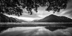This beautiful black and white landscape photo was taken from the Great Alpine Highway as Anthony scrambled down from a bridge fairly close to Arthurs Pass to capture this photo. The mountain, sky and the reflection gave great ingredients to play with, but in addition Anthony also included the tree as another element to add depth. The strong contrast of black and white really adds to the impact of this shot.