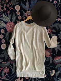 Cozy up in this high low knit tunic sweater with long sleeves and round neck. Perfect for brunch, laying around the house or those cool spring nights.