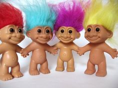 Troll dolls....I had several and learned to hand sew making clothes for them