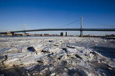 Ice collects on the Delaware River in view of the Benjamin Franklin Bridge in Philadelphia...