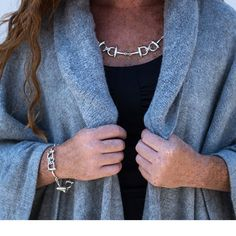 "A little something to catch the light. Measuring almost 24"", our double chained horse bit necklace is in sterling silver and fits beautiful over any neckline. It is featured here, paired with our Baby Alpaca Cape and matching Sterling Silver Horse Bit Bracelet. Part of Caracol Silver's Fall Collection for 2016 - Price: $499.00"