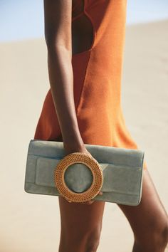 Our oversized Gemma Clutch brings the drama with her structural shape and oversized rattan ring detail that allows for an easy hold. Inspired by our well-loved Gemma Belt, this classic bag in Seaspray suede gives room for ample storage, with three compartments and a detachable strap. She's equal parts functional and b