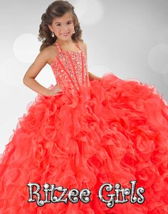 Size 12 Tangerine In Stock! Immidiate Shipping!Gorgeous Ritzee Girls Pageant Dress 6349. This floor length pageant gown features halter neckline, fitted and beaded bodice, and lace up back. A ruffled ball gown skirt completes the look of this dress. This sweet dress will make your girl feel like a princess. Available in Tangerine, Turquoise, Neon Pink and Purple.