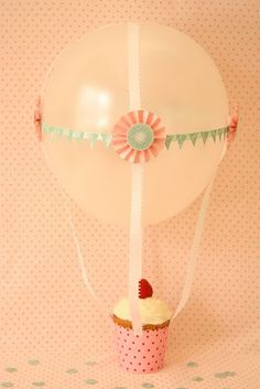 a helium balloon connected to a cuppy cake:)