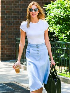 Star Tracks: Tuesday, May 24, 2016 | SPRING STYLE  | Karlie Kloss is seen out in New York City in a T-shirt and denim skirt Monday.
