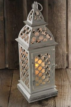 Great web site. White Battery Operated Flickering Candle Lantern w/Remote