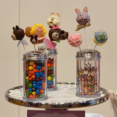 Cake Pops Display - use salt & pepper shakers filled with a colorful candy! Confetti may work or grass or paper shreds?