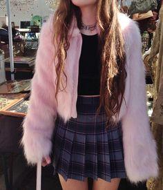 fluffy pink jacket and tartan skirt