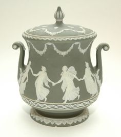 A WEDGWOOD GREEN AND WHITE JASPER WARE TWO HANDLED BISCUIT BARREL MADE IN 1906.