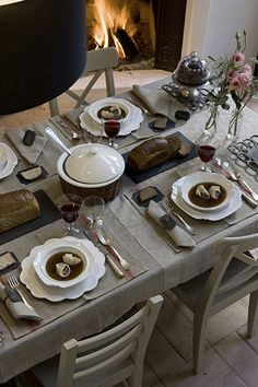 linen tablecloth and place settings give natural luxury to this party.  could switch out modern dishes for an updated look.