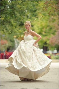 bride twirling in ruffled wedding gown #awesomeweddings