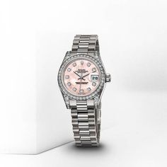 The ladies' datejust by Rolex in white gold with pink mother of pearl face with diamond inlay, diamond dial, and diamond accents. Love love love it!