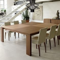 Why is it so hard to find a square dining table that seats 12?
