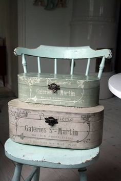 Shabby chic hinged boxes on a blue chair