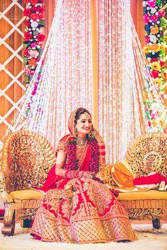 red and gold bridal lehenga ,heavy lehenga , classic lehenga m, heavily embellished , stunning , gorgeous ,intricate work lehenga