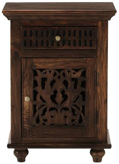 What a great nightstand! The hand-carved details give it such character. HomeDecorators.com