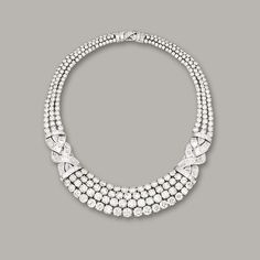 IMPORTANT DIAMOND NECKLACE, GRAFF. The necklace set to the front with four rows of graduated brilliant-cut diamonds, to the shoulders set with articulated scrolls set with baguette and tapered baguette diamonds, completed at the back by three rows of brilliant-cut diamonds, the diamonds together weighing approximately 90.66 carats, mounted in platinum, length approximately 390mm, signed and numbered 3777.