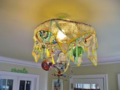 Chrystal Chandelier! I made this one out of old copper wire, coat hangers, crystal wine glasses, earrings, necklaces, cut glass, a scarf, ribbons, beads from Israel,  Christmas ornaments, and a mosaic coaster! Much better than the antique 600$ light I wanted.