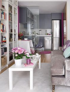 tiny spaces, living room and kitchen, grey and purple tones. Hopefully the wall behind the camera is where the living area window is!
