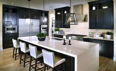 This chef-style kitchen with oversized island with seating is perfect for everyday meals. - Residence 3 at Kingston at Del Sur in San Diego, CA