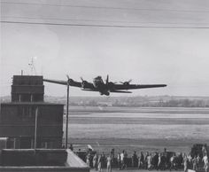 SUPER LOW PASS B-17F Fortress aircraft of the 91st BG, 8th Air Force executing a low fly-over during a demonstration at Bassingbourn, England, United Kingdom, 1943, Source United States Army via Michael Smith Added By David Stubblebine
